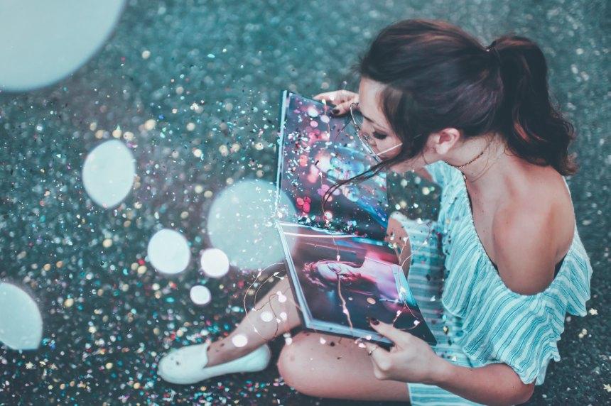 girl reading book glitter